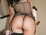 Sexy Latina in Black Fishnet Showing Big Ass on Photo Camera