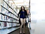 Sexy girl secretly undressing and flashing in a public library